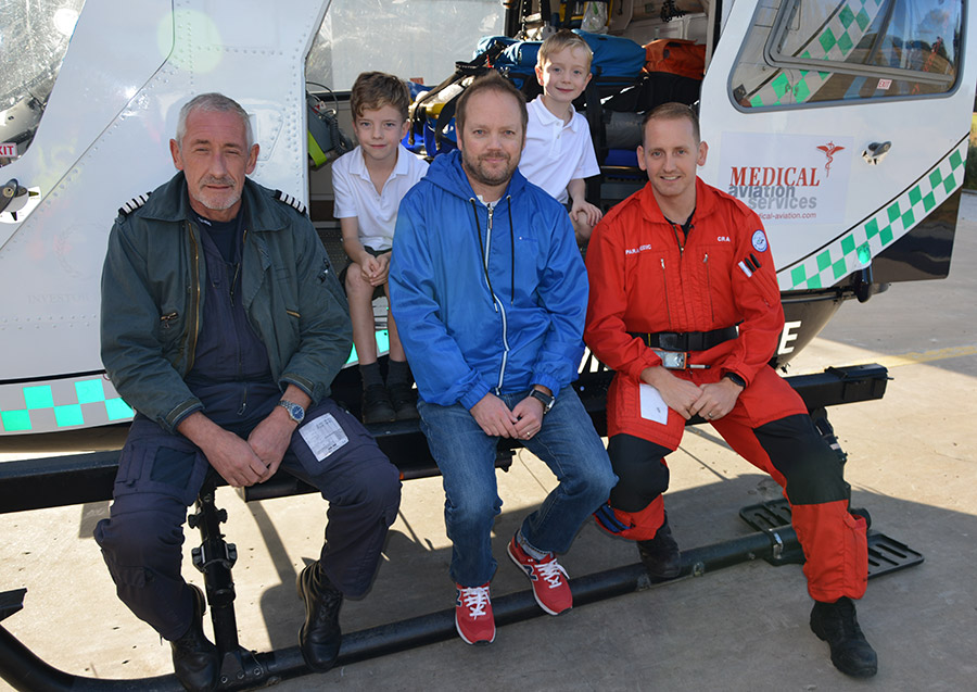 Warren and his two boys with Captain Blaine Ashurst (Left) and Paramedic Craig Prentice (Right). Photo taken in 2016