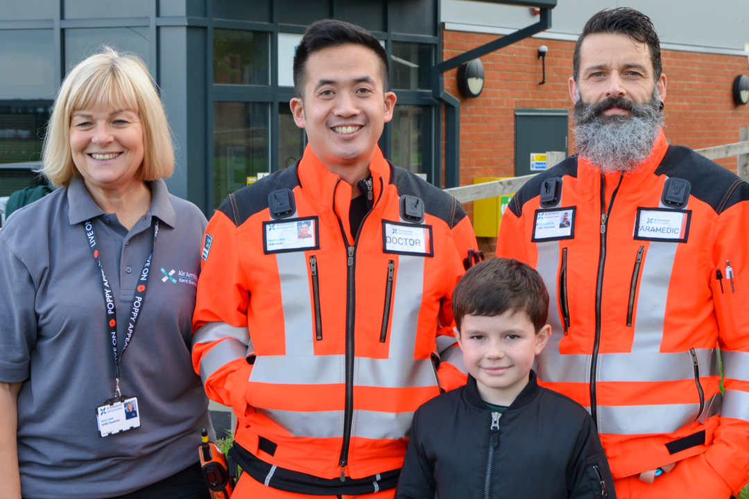 2019 Base visit, from left to right : HEMS Dispatcher Carole Lewis, Dr Matthew Mak, Charlie (former patient), and Paramedic Al Crawford